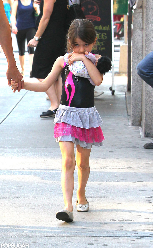 Suri Cruise held tight to her baby-doll in NYC.