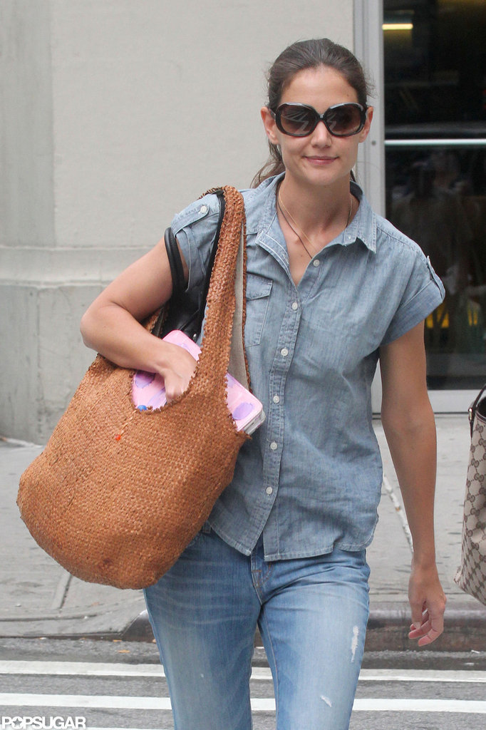 Katie Holmes carried a full load with her as she strolled through NYC.