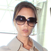 Victoria Beckham in a Cape Coat at LAX