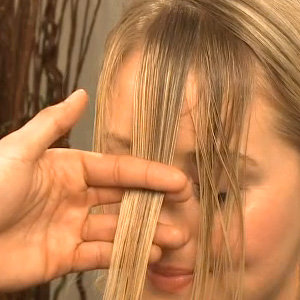 Tempted To Cut Your Own Bangs at Home? Watch This First!