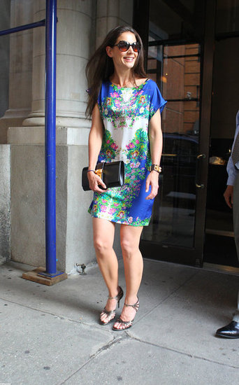 Katie Holmes chose a silky cap-sleeved floral Zara shirtdress and metallic sandals for a Summery evening out. We love the easy evening-appropriate versatility of this shift — with just the addition of cool high-top sneakers, you've got a dressed-down take on this pretty ensemble.