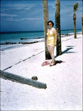 1950s That gold suit glams up the beach. Source: Flickr User hartman045