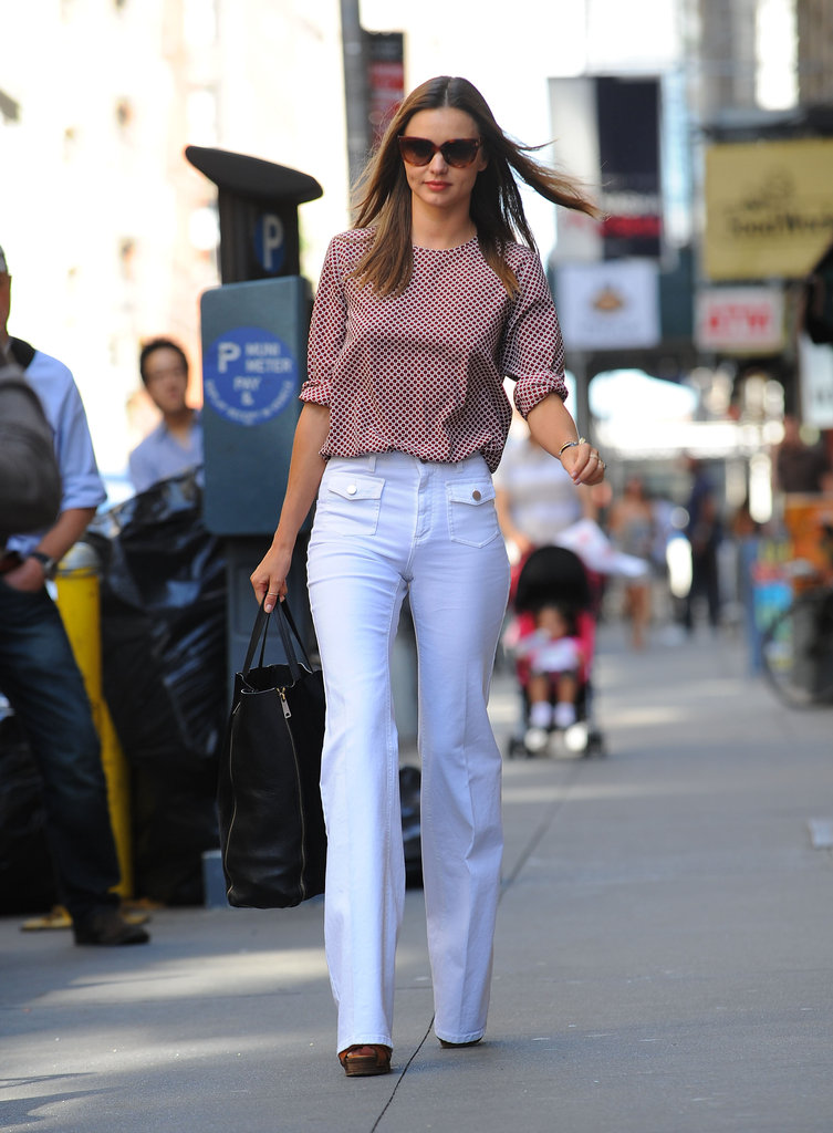 Miranda Kerr showed off her long legs in white pants in NYC.