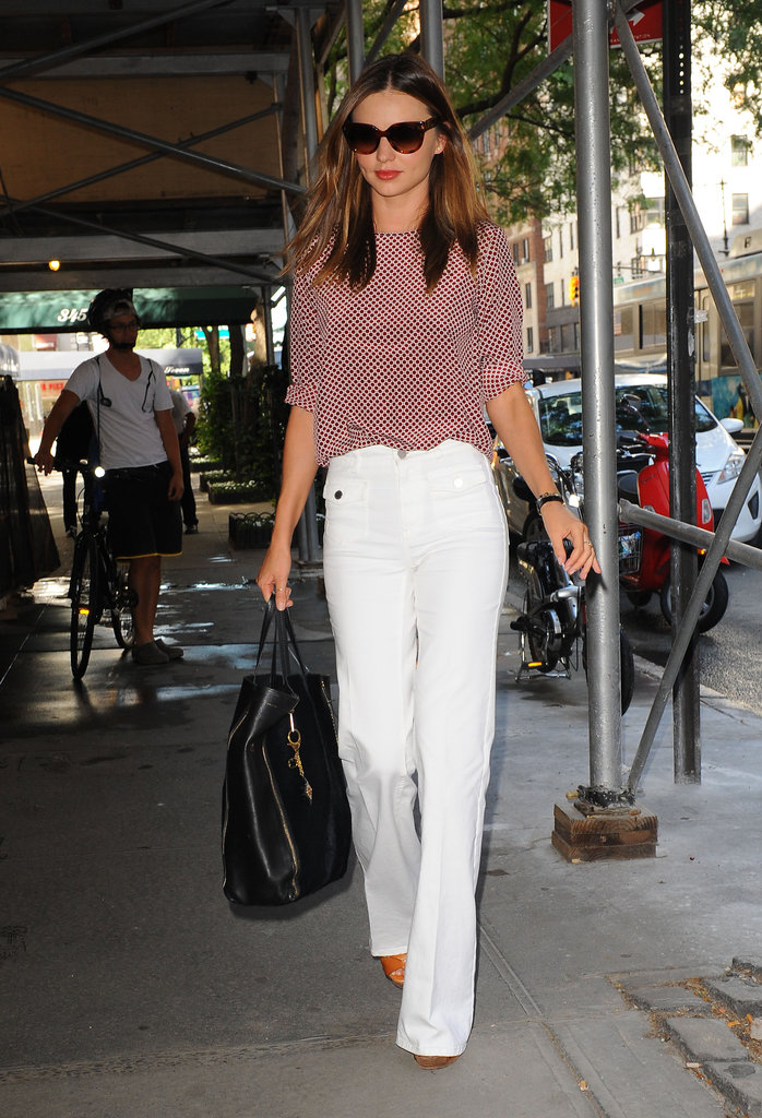 Miranda Kerr wore white pants and a red polka-dot shirt in NYC.