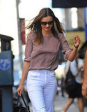 Miranda Kerr wore sunglasses and white pants in NYC.