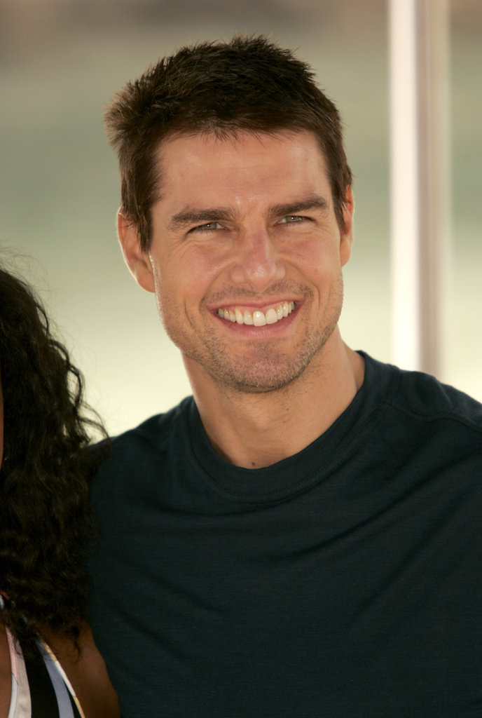 Tom Cruise looked happy to be at the Venice Film Festival for his Collateral photocall in September 2004.