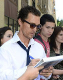 Matthew McConaughey kept busy signing autographs for fans.