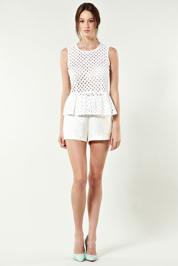 Maintain a cool peplum shape and catch whatever breeze there may be via the handy cutout mesh details. Warehouse Cutwork Peplum Shell Top ($62)