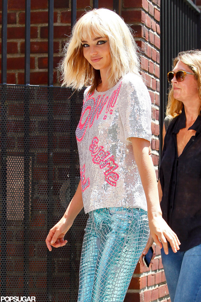 Miranda Kerr smiled under a blond wig in NYC.