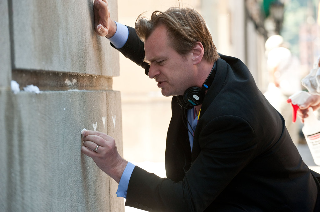 Director Christopher Nolan on the set of The Dark Knight Rises.  Photo courtesy of Warner Bros.