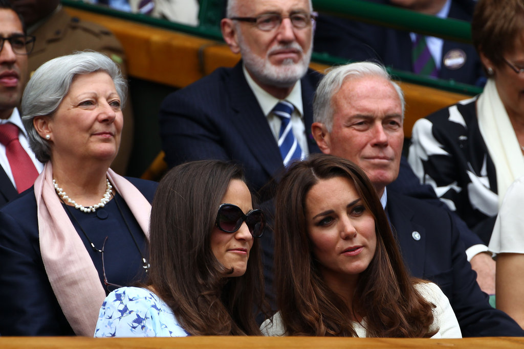 Pippa Middleton put on sunglasses while chatting with her sister Kate.