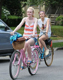 Dakota Fanning & Elizabeth Olsen Look Cute Riding Bikes for Their New Movie: Very Good Girls