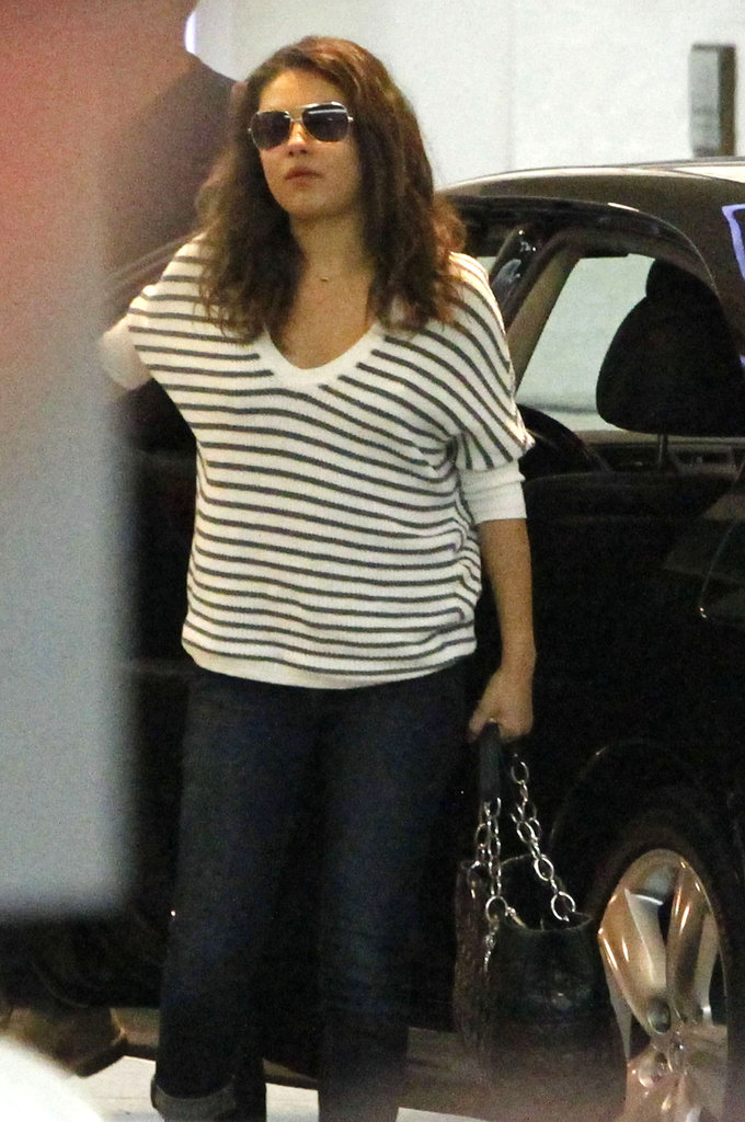 Mila Kunis wore a striped shirt.