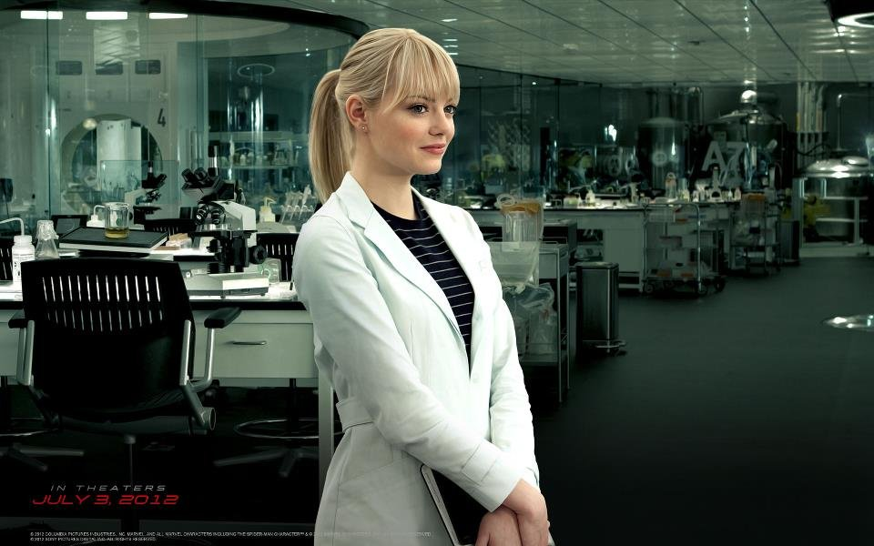 Gwen sporting a white coat with a striped top.  7338029