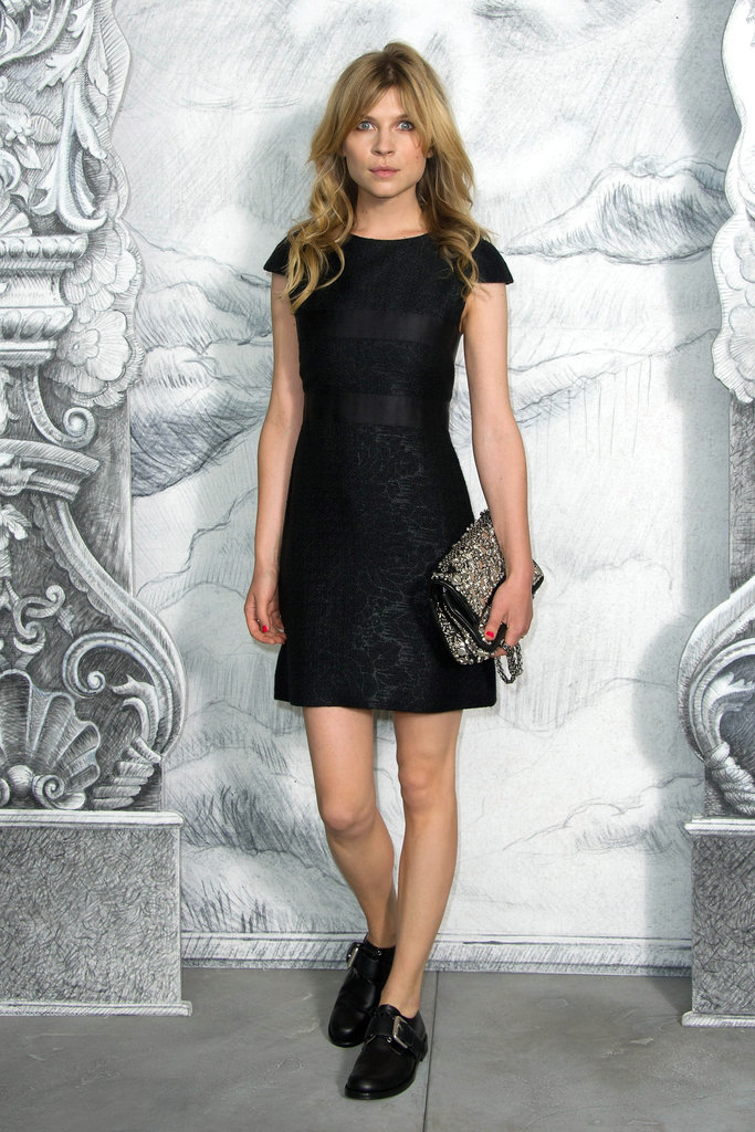 Clemence Poesy struck at pose at the Chanel photocall in Paris.