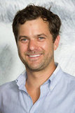 Joshua Jackson gave a smile at the Chanel photo call in Paris.
