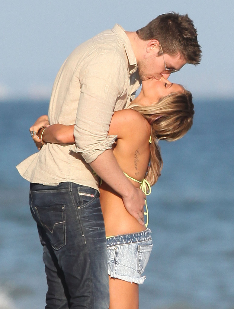 Ashley Tisdale and Scott Speer had a passionate kiss on the beach for her birthday.