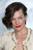 Milla Jovovich sported bright lips at the Chanel photo call in Paris.