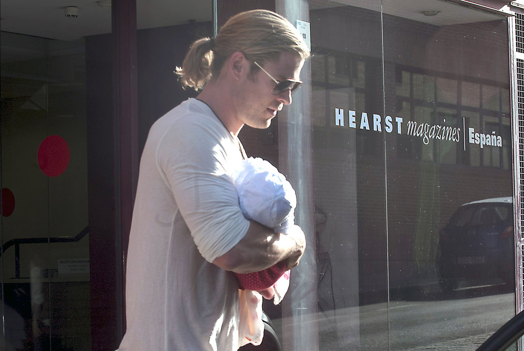 Chris Hemsworth carried baby India in his arms out and about in Madrid.