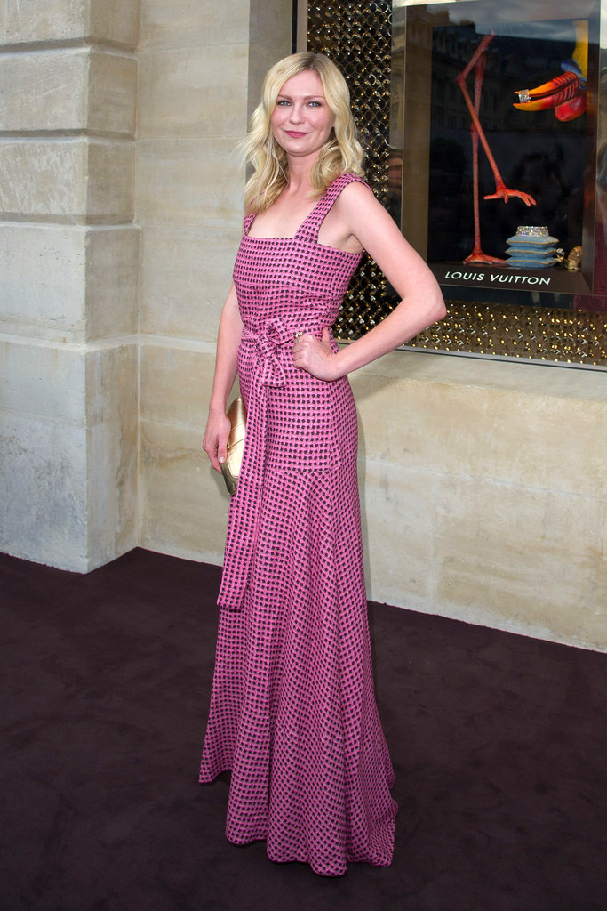 Kirsten Dunst was simply stunning in a bow-tied maxi at Louis Vuitton's store opening during Couture Fashion Week.