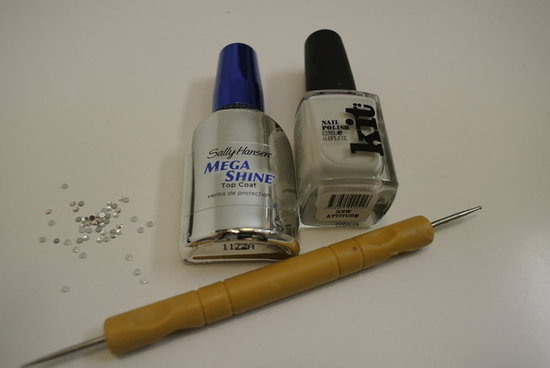 I used Kit Cosmetics nail polish in New Attitude as I thought the eggshell white would complement the diamante look. You'll also need a stylus tool — cheap and easily sourced from a craft store.