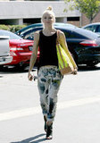 Gwen Stefani showed off her eye-catching everyday style with a neoprene tote and printed trousers.
