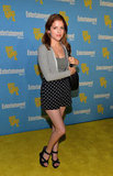 Anna Kendrick exuded a retro vibe by styling up high-waisted printed shorts and wedge sandals.