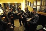 Charles Esten, Jason Carter, Ronnie McCoury, Del McCoury, and Rob McCoury on Nashville. Photo copyright 2012 ABC, Inc.