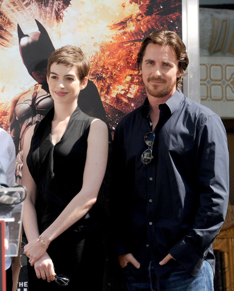 Anne Hathaway and Christian Bale linked up for Christopher Nolan's hand and footprint ceremony in LA.
