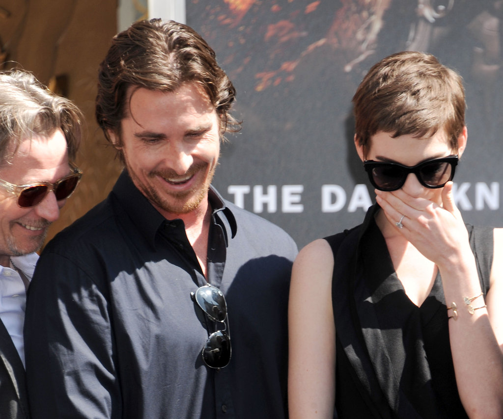 Christian Bale and Anne Hathaway had a laugh together at Christopher Nolan's hand and footprint ceremony in LA.