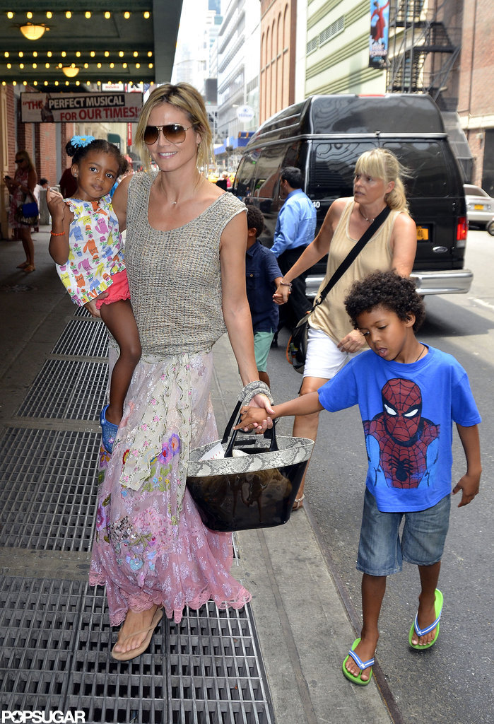 Heidi Klum pulled her hair up while hanging out with her kids in NYC.