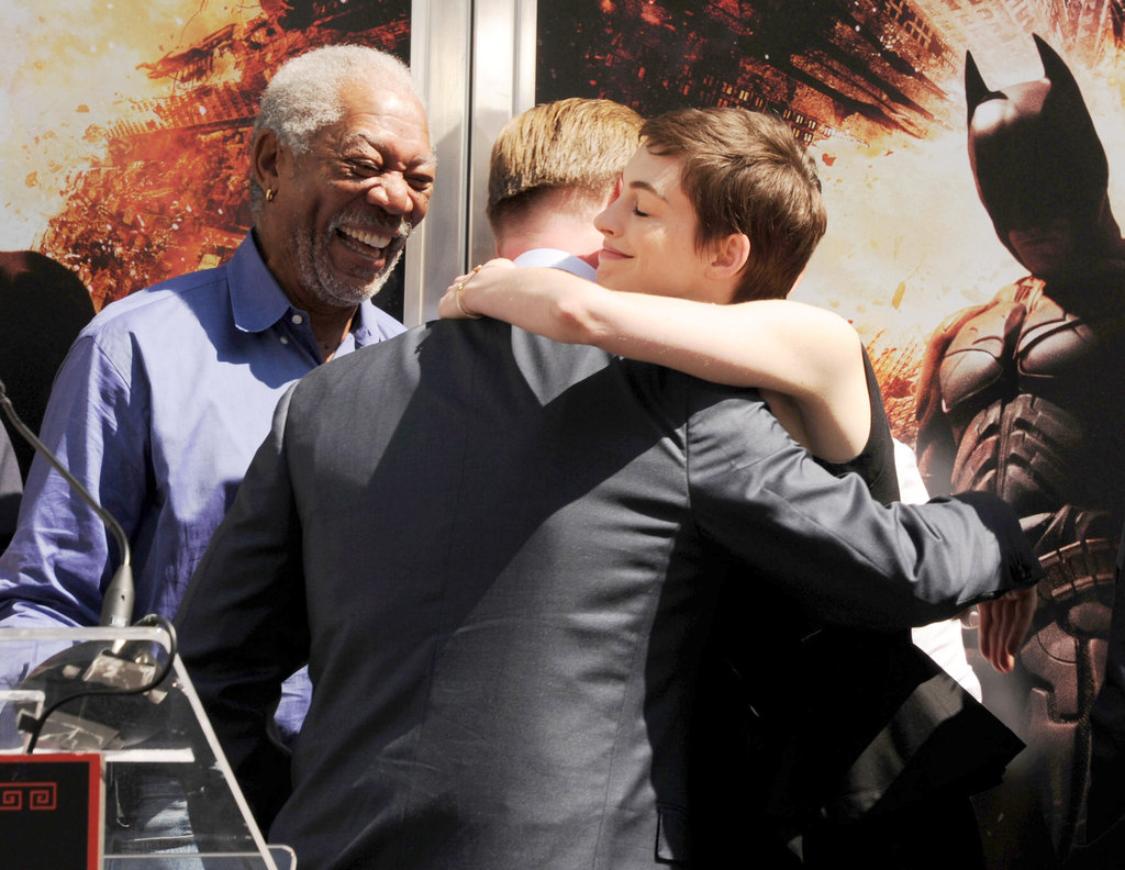 Anne Hathaway congratulated Christopher Nolan with Morgan Freeman at Christopher's hand and footprint ceremony in LA.