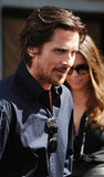 Christian Bale wore a black shirt to Christopher Nolan's hand and footprint ceremony in LA.
