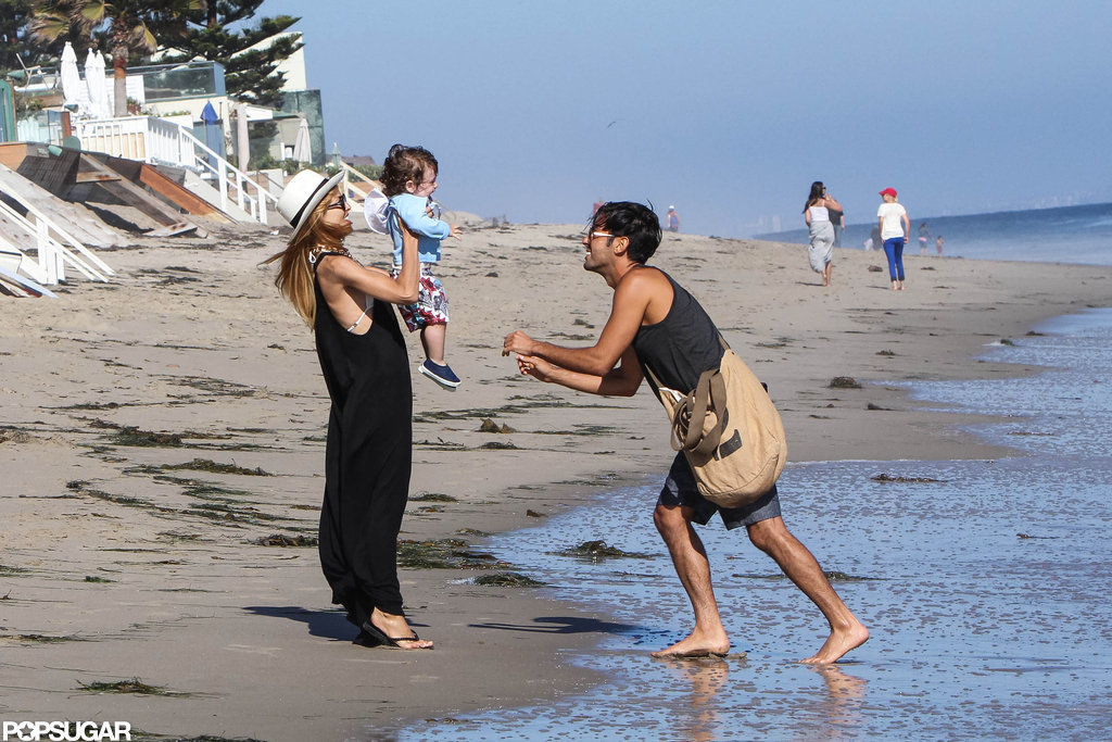 Rachel Zoe and her friend held Skyler on the beach in Malibu.
