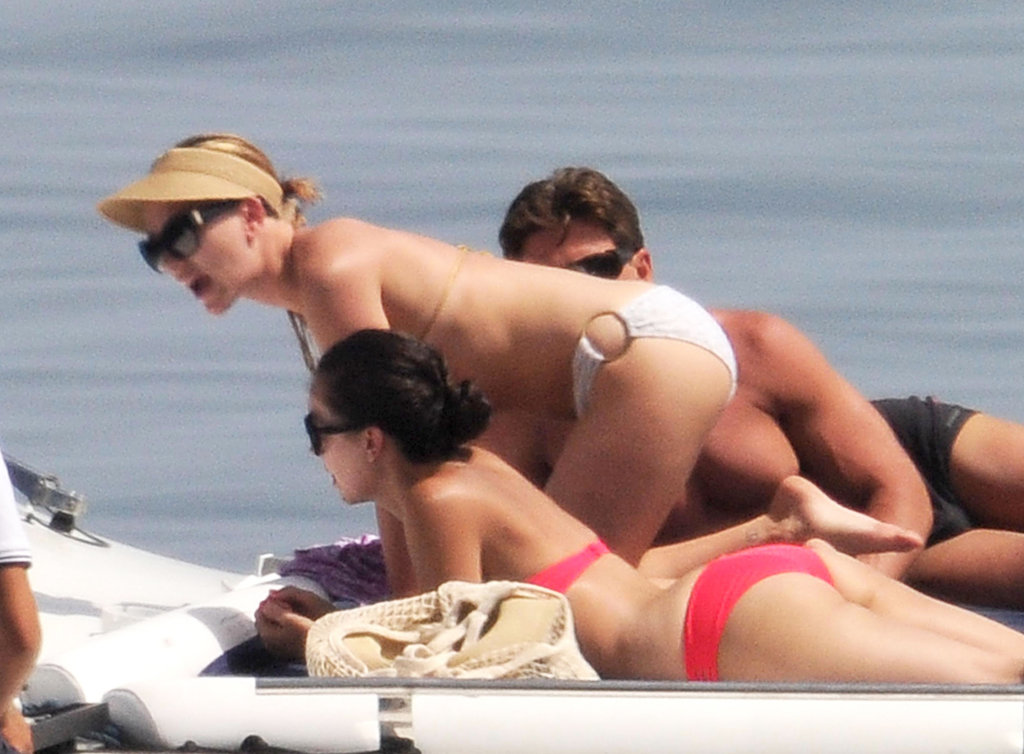 Scarlett Johansson sported a visor and sunglasses as she laid out.