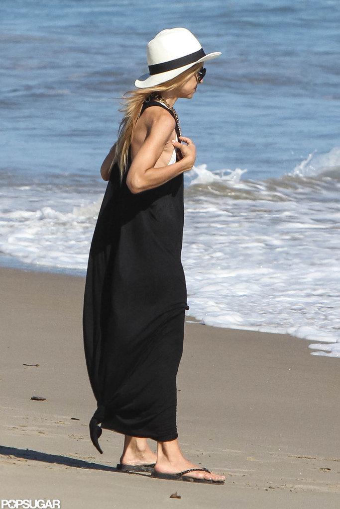 Rachel Zoe wore a long black maxi dress to the beach in Malibu.