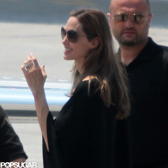 Angelina Jolie showed off her engagement ring leaving Bosnia.