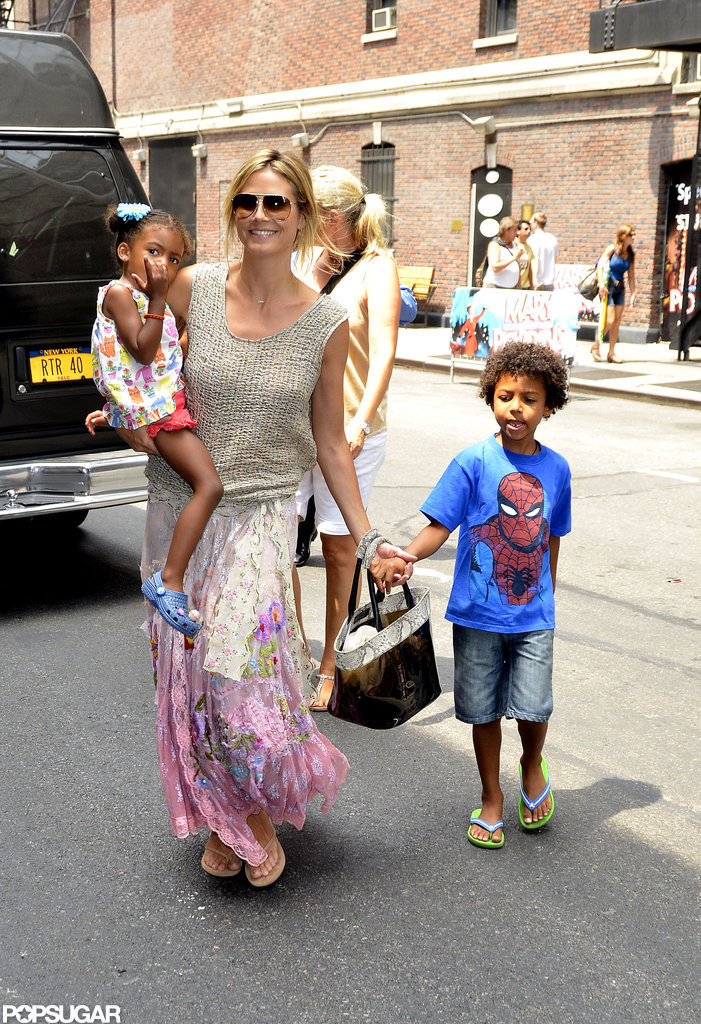 Heidi Klum smiled and was holding on to her little ones in NYC.