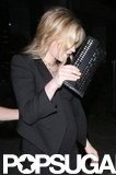 Anna Paquin carried a cute black clutch with her as she left BOA Steakhouse.