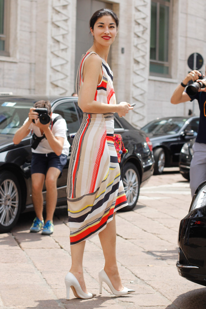 Caroline Issa is at it again in the coolest kind of striped dress and metallic toe-cap heels.