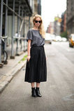 This is simple enough, but we love how a pleated midi skirt puts a sweeter spin on a basic blouse and boots. Photo courtesy of Adam Katz Sinding