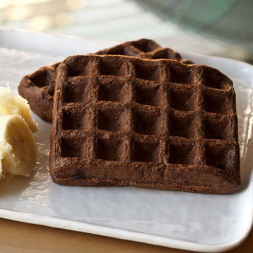 Get your grain on with these whole wheat, vegan waffles. Don't let the recipe scare you; the cocoa powder gives them just the sweetness they need without adding a whole bunch of calories.