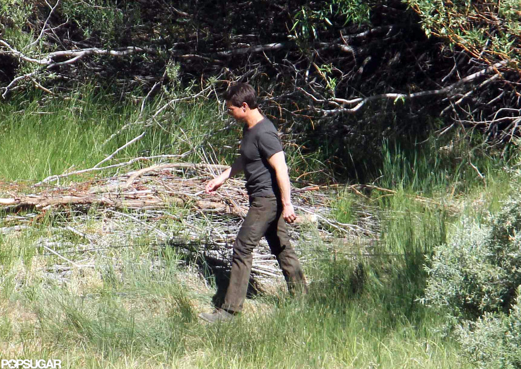 Tom Cruise hiked through a wooded area in June Lake, CA on the set of Oblivion.