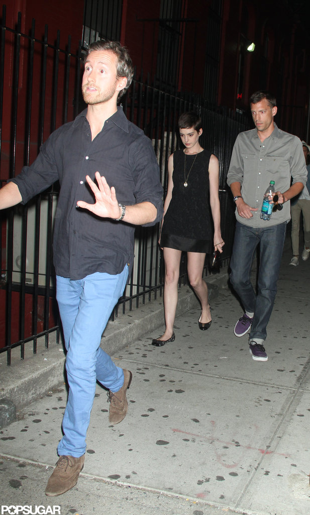Adam Schulman walked infront of Anne Hathaway leaving the Shut Up & Play the Hits screening in NYC.