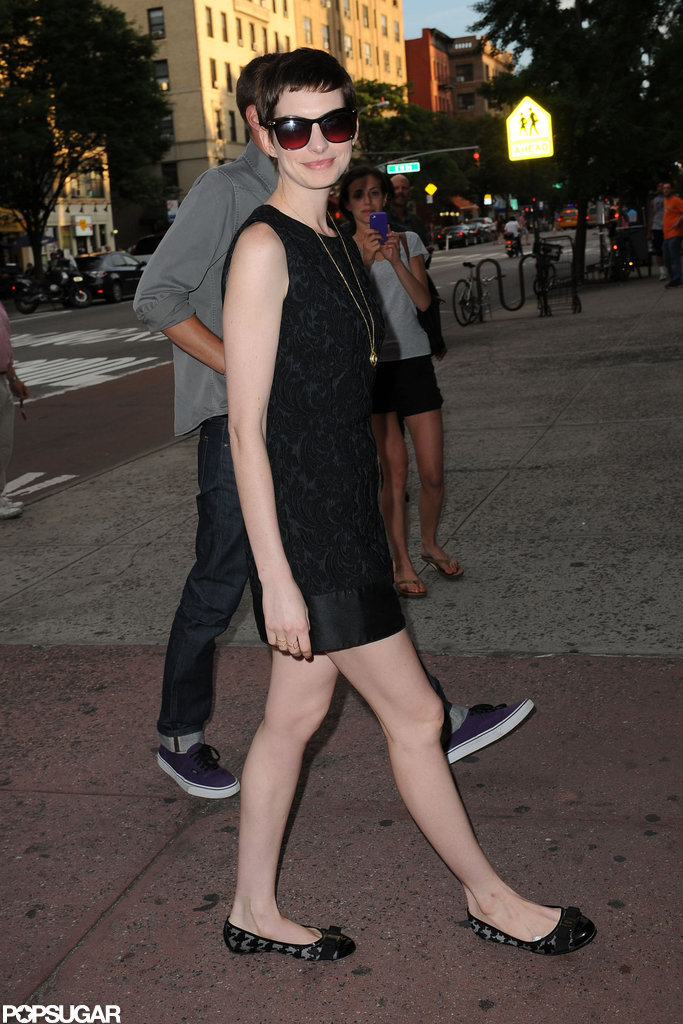 Anne Hathaway walked into the Shut Up & Play the Hits screening in NYC.