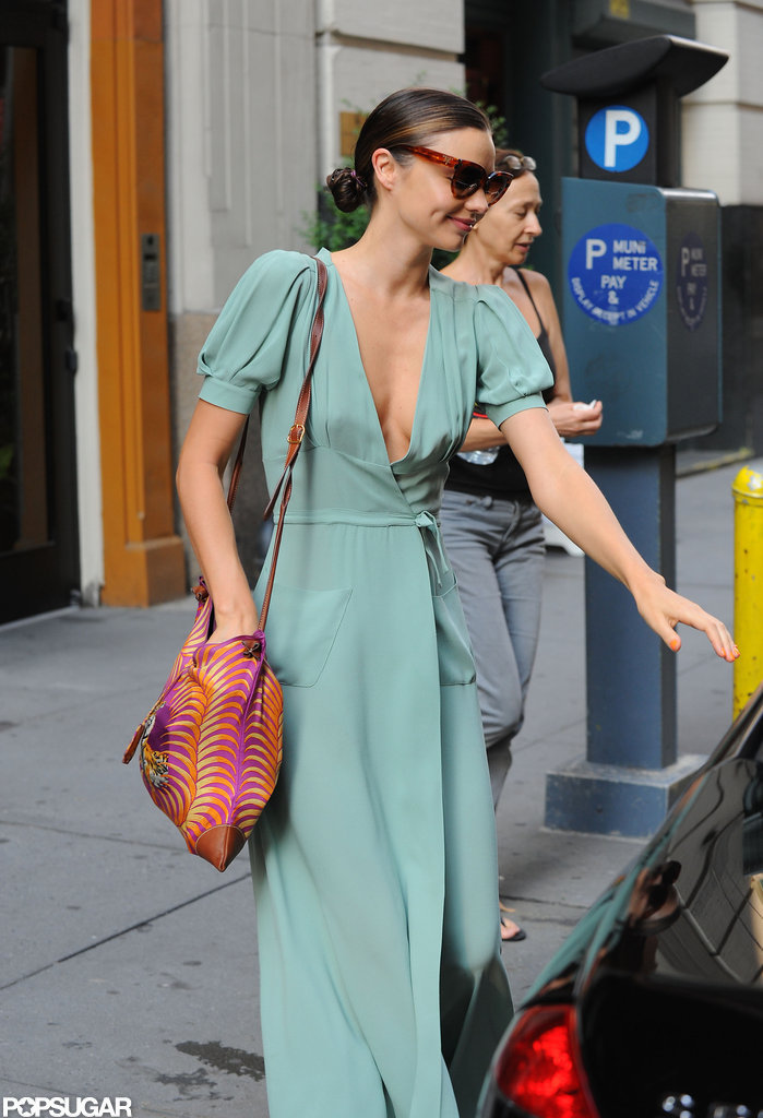 Miranda Kerr flashed a smile in shades.