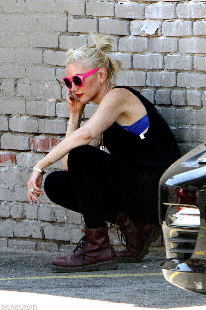 Gwen Stefani let a purple bra show under her black tank top.