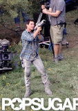 Tom Cruise took aim on set.