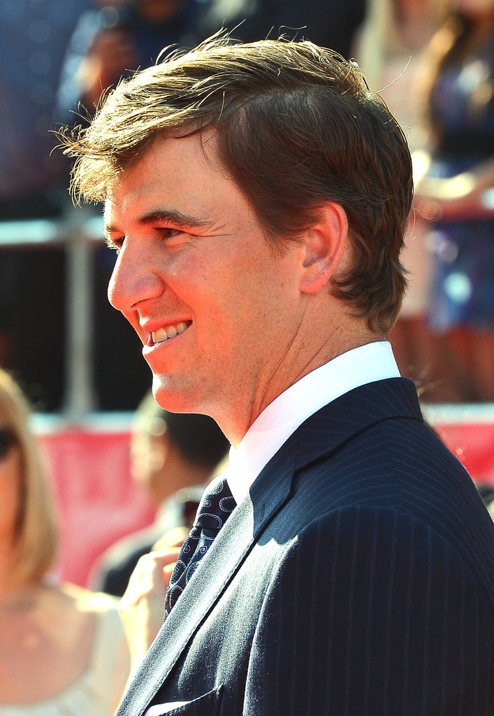 Eli Manning looked handsome as he flashed a smile on the red carpet.