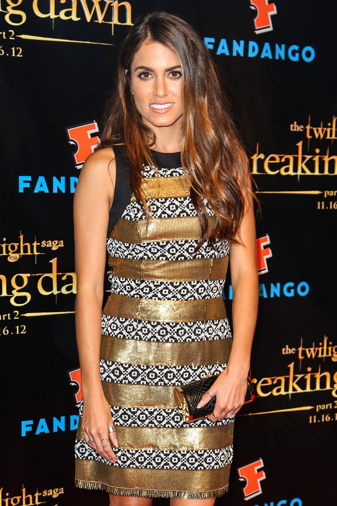 Nikki Reed struck a pose in a gold and black patterned dress at the Breaking Dawn Part 2 party at Comic-Con.